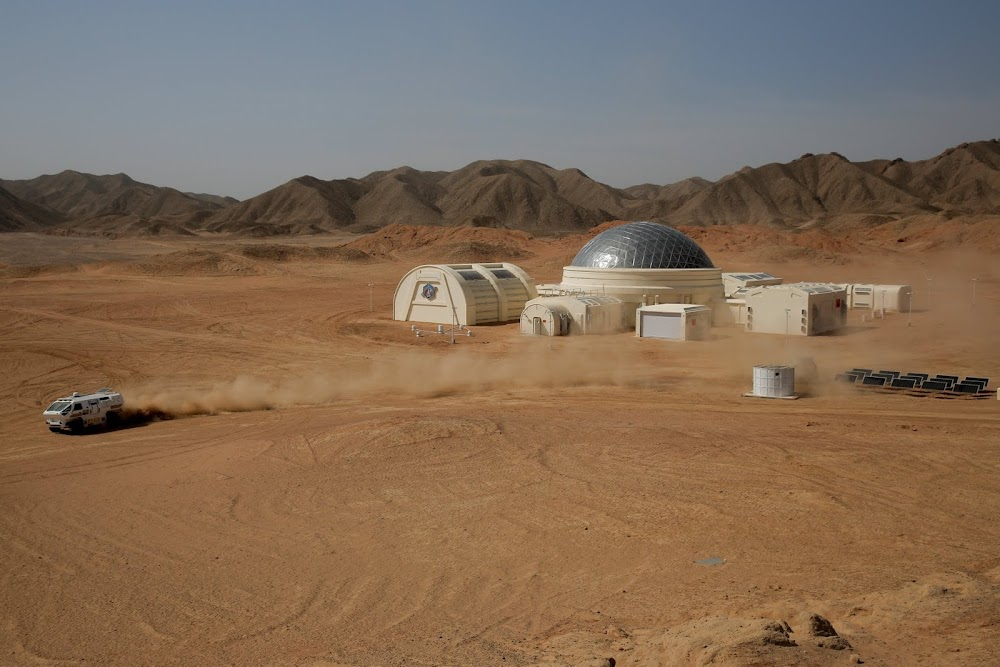 Rover racing at China's C-Space Mars simulation base in Gobi desert