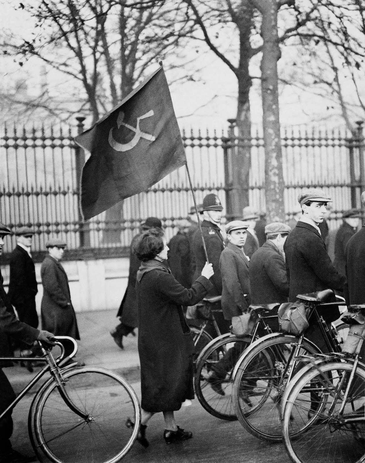 A woman leading a Communist march in London. 1928.
