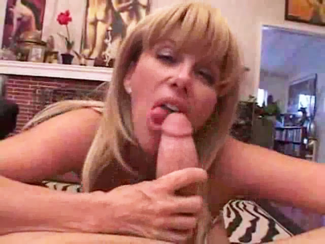 mom jerked her son's cock with her big jugs