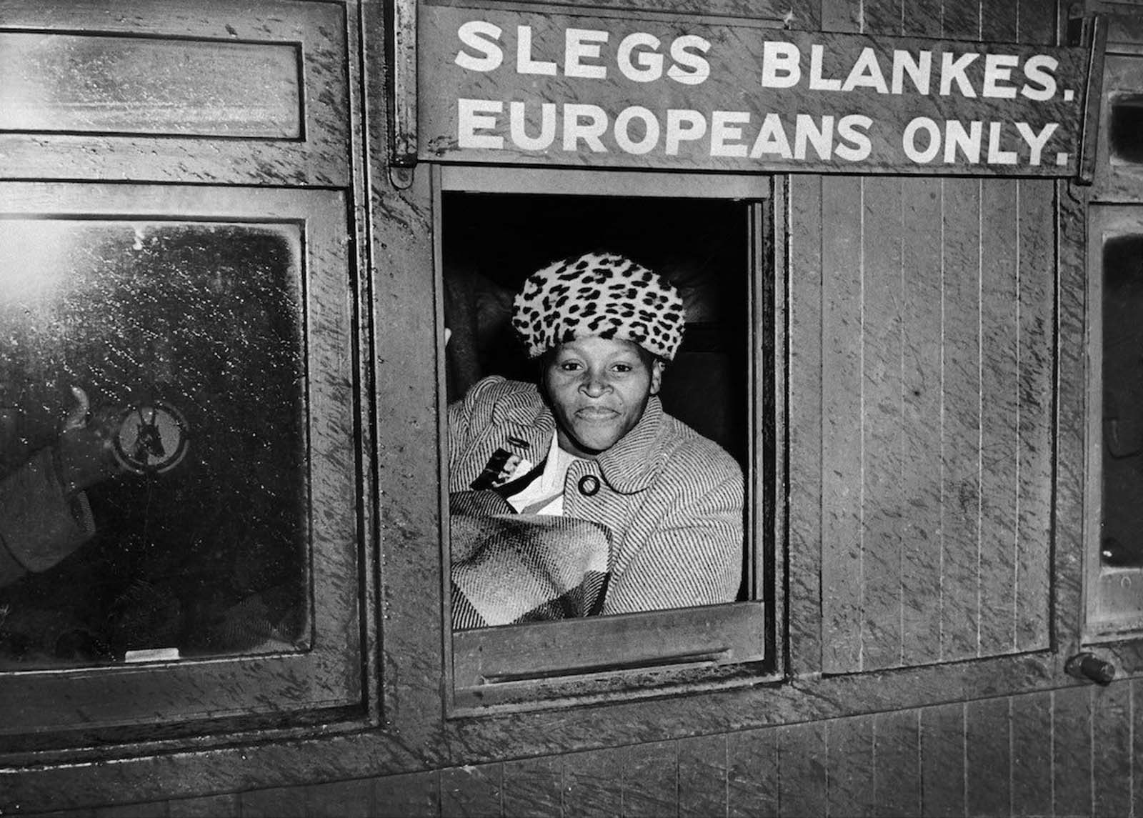 A woman sat in the wagon reserved for White people to protest against Apartheid. 1952.