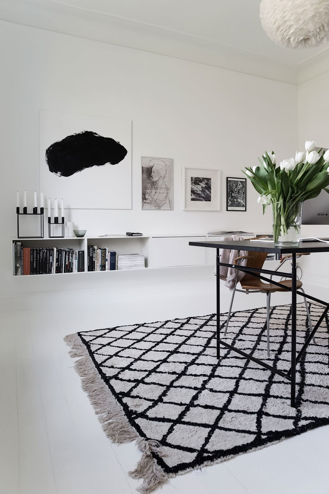 black and white interior design, nordic home, black furniture, white floor, monochrome decor, textured rug, arne jacobsen chair