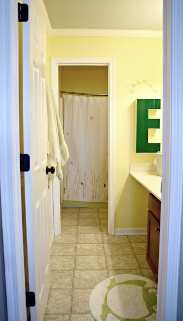 Bathroom makeover with wall separating spaces