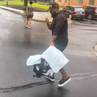 Photo :Timaya steps out with new born son