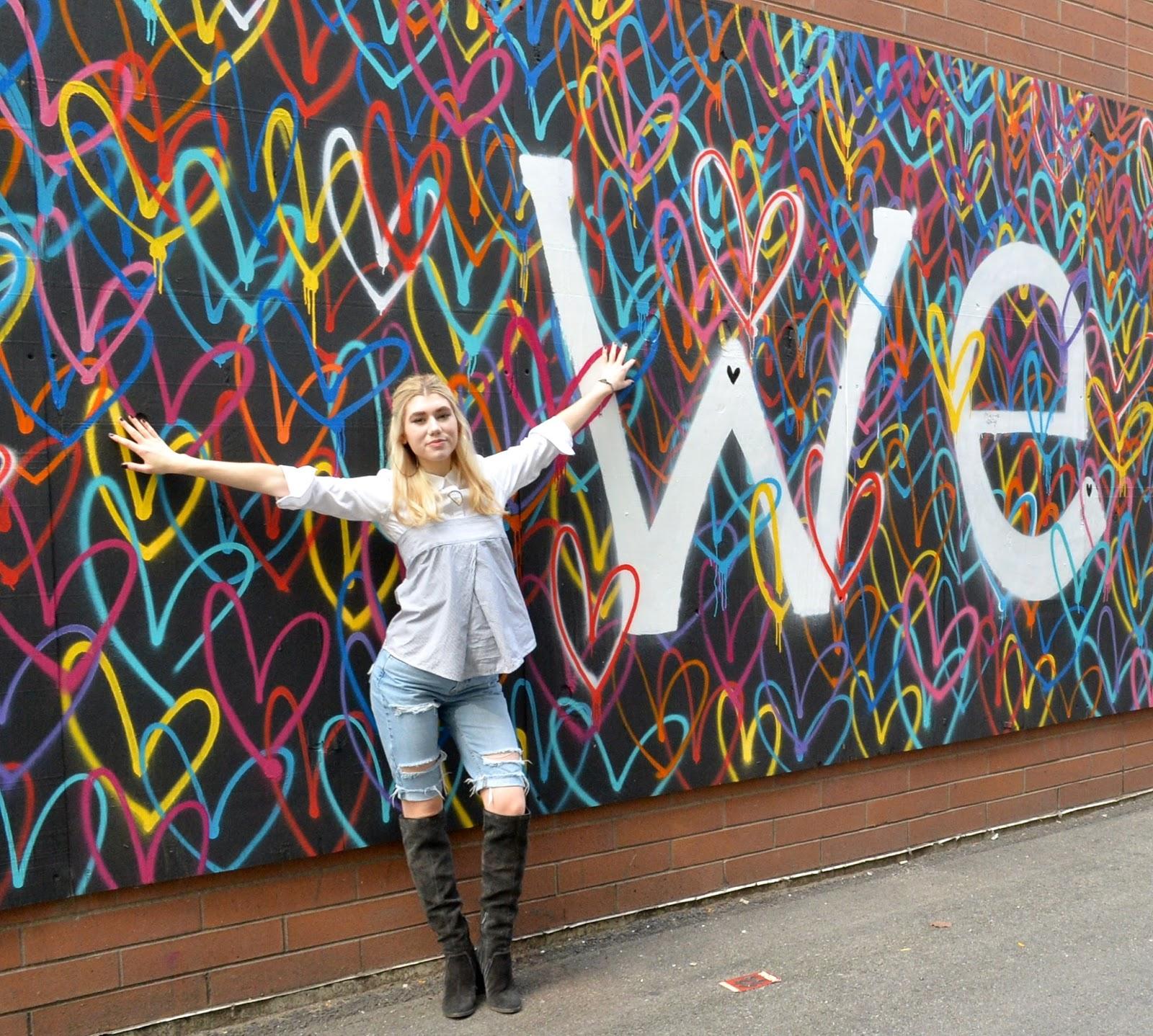 Hugging a Chicago bleeding hearts mural in Wicker Park
