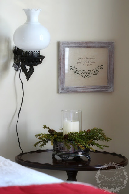 Silver dish turned candle holder in the guest room