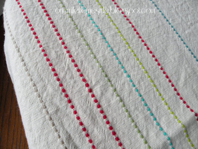 Khaki and multi-color striped tablecloth