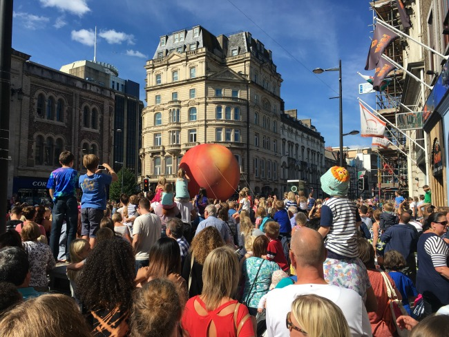 City-Of-The-Unexpected-Cardiff-Celebrates-Roald-Dahl-crowds-waiting-for-something-oh-it's-a-giant-peach