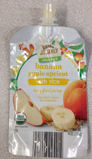 An empty pouch of Little Journey Organics Banana Apple Apricot with Rice Baby Food Puree, from Aldi