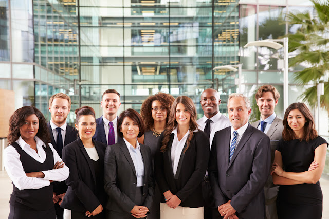 Group of business people outside office diverse