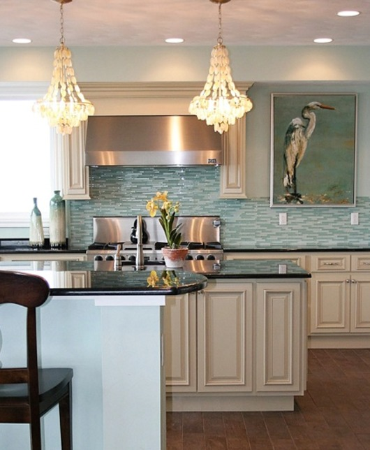This Coastal Kitchen By E A Interior Design Shows Two Eye Catching Design  Ideas. A Shimmering Glass Tile Backsplash In A Watery Hue, As Well As A  Large ...