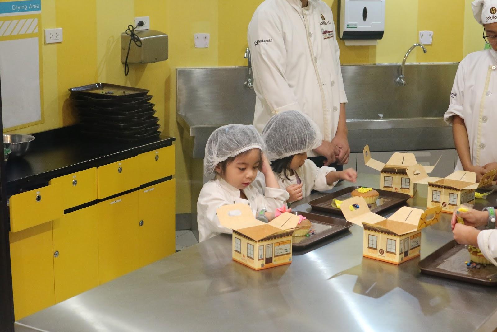Chloe baking in KidZania Manila