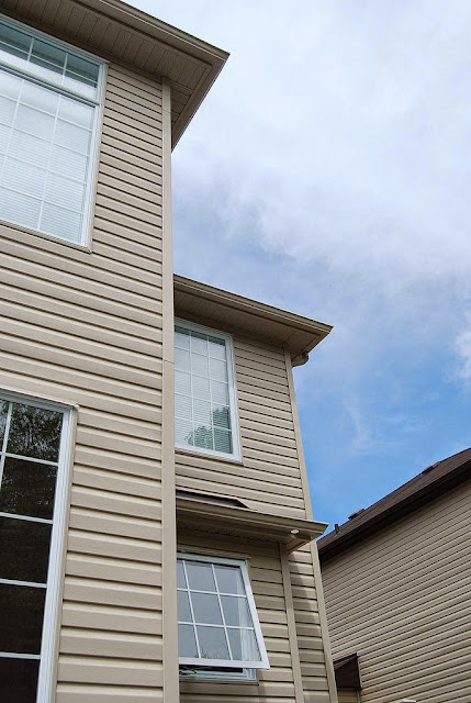 Replacing Vinyl Siding with Wood picture