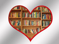Heart shaped frame with full bookcases within it.
