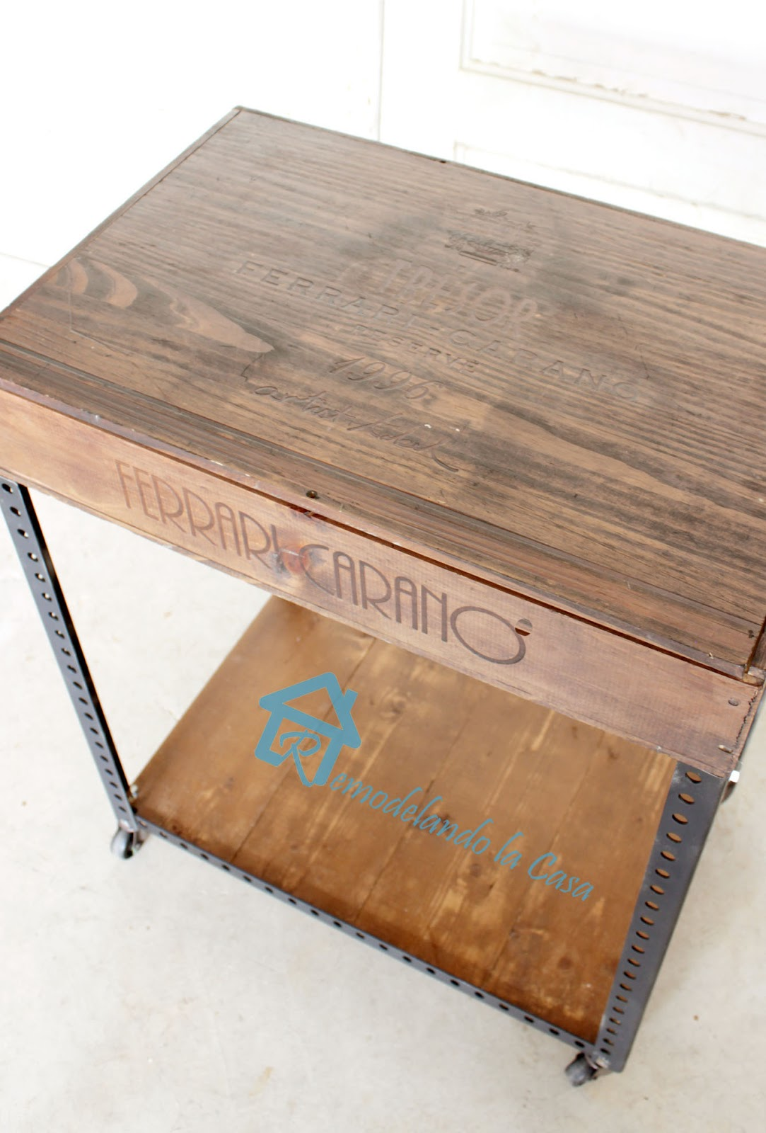 a wine box is repurposed with some metal brackets into an Industrial side table.