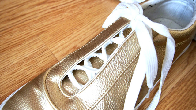 close up of gold trainers