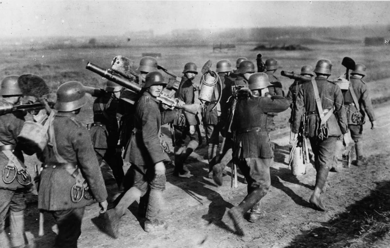 German troops carry Lewis gun equipment.