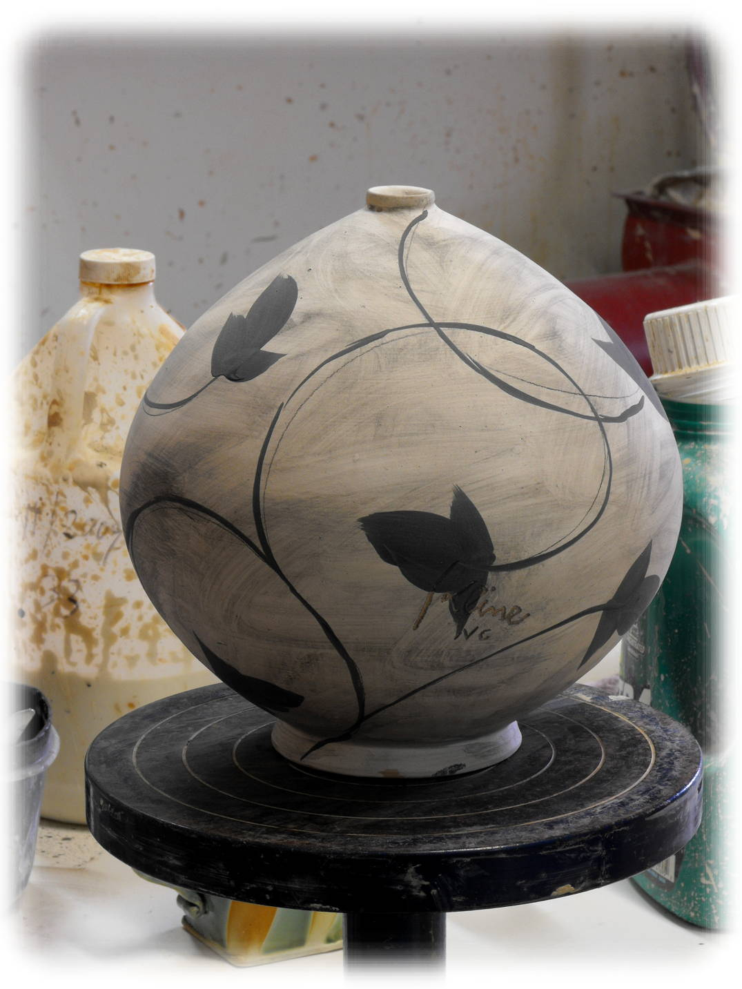 pottery technique round spherical closed form potter's wheel brush work vine botanical