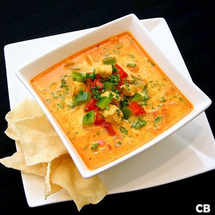 Recept Romige Indiase currysoep met gemarineerde kipblokjes en groenten