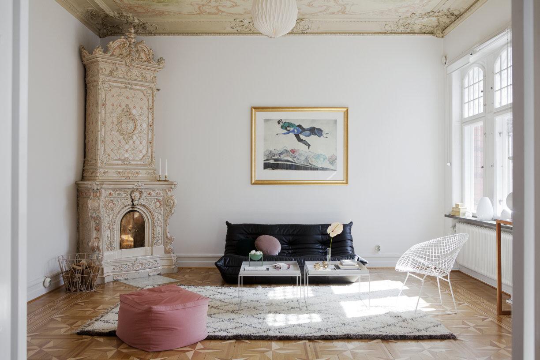 beautiul scandinavian apartment with luxury elements, mid century modern furniture, fireplace