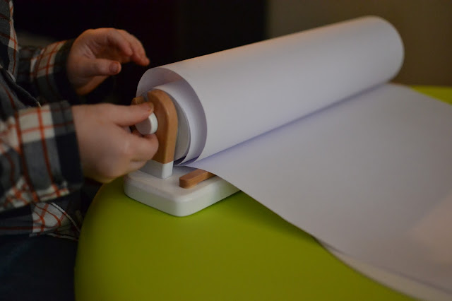 Art Paper Roll Dispenser