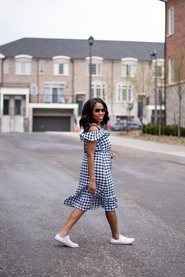 woman wearing a gingham spring dress