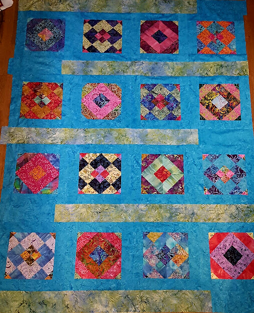 https://amyscrapspot.blogspot.com/2016/10/batiks-quilt-top-almost-assembled.html