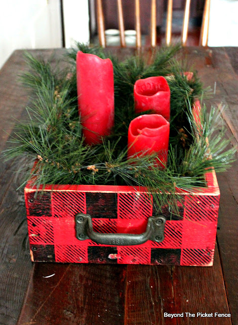 make a simple rustic centerpiece with a crate and old sign stencils