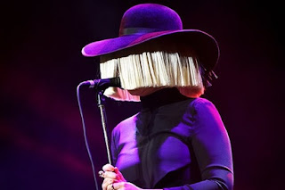 Sia performs her song Cheap Thrills on The Voice season Finale. Watch now at JasonSantoro.com