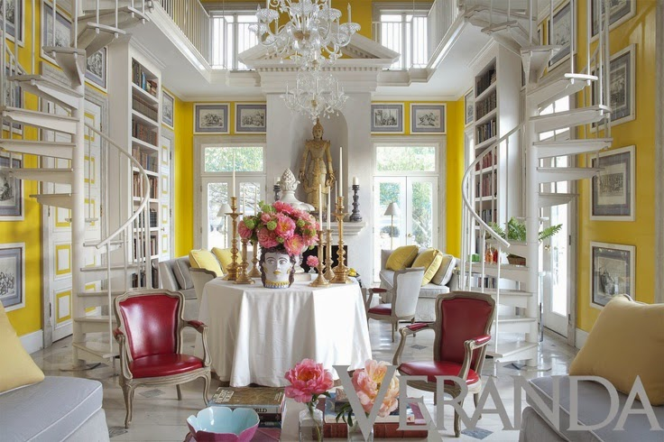 White And Soft Grey Set The Stage But Bright Yellow Walls Pink Flowers Chairs Bordering On Red Are Stars Of This Room