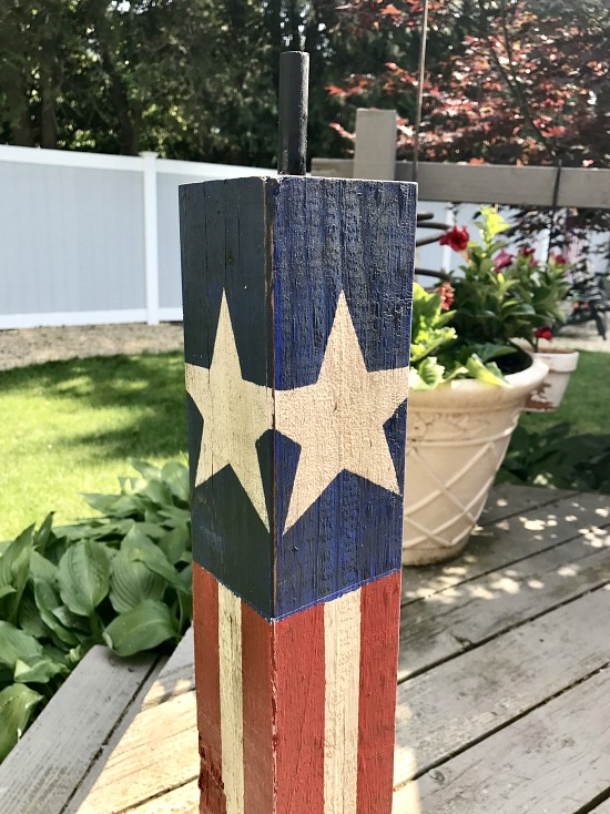 wooden firecracker for the fourth of July adding a fuse
