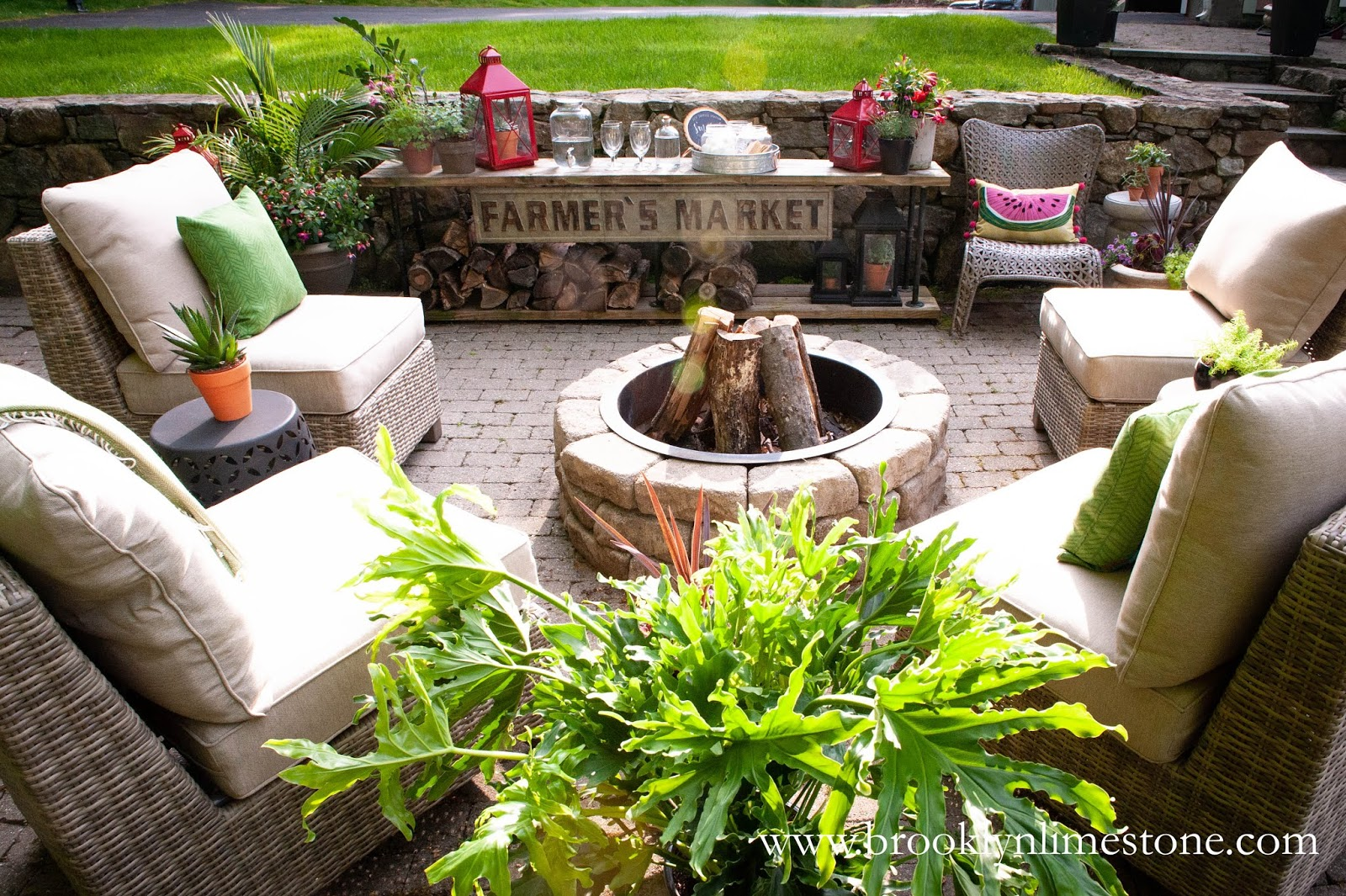 diy firepit and armless chairs on stone patio