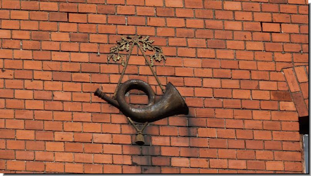 Remains German horn on building wall