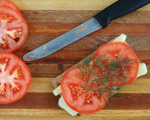 For sharp, clean tomato slices (and so many other kitchen cutting tasks), pick up a tomato knife, a short serrated knife. Another Quick Tip ♥ KitchenParade.com.