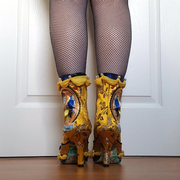 back view of yellow brocade boots with slim heel and yellow draping