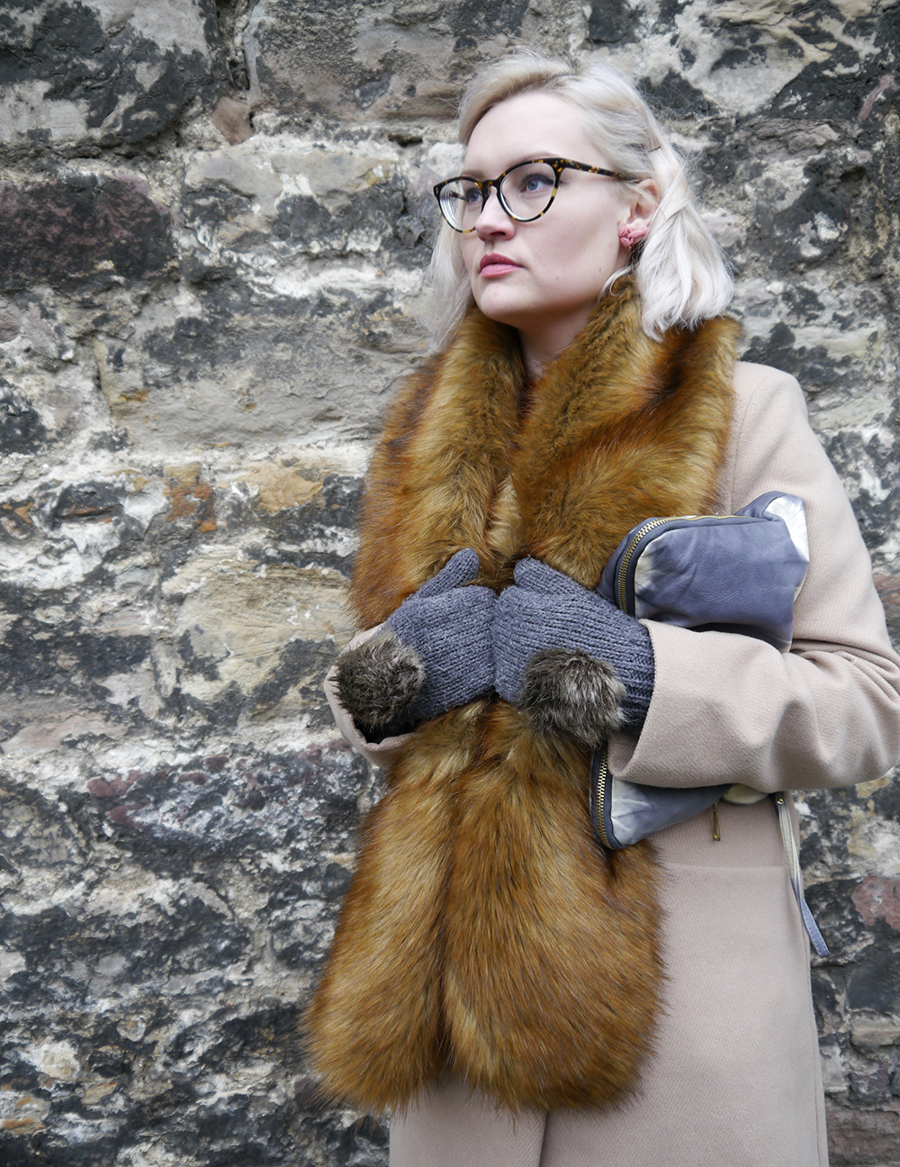 Scottish fashion blogger Wardrobe Conversations wearing faux fur trend with rabbit mittens at Edinburgh Castle