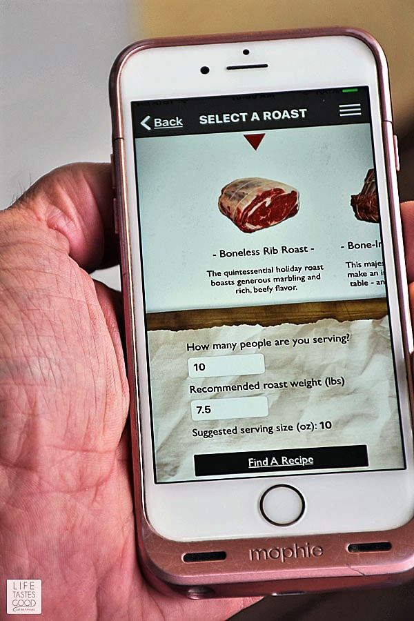 A picture of my husband using the Roast Perfect App to get the perfect sized boneless prime rib roast for our Christmas dinner