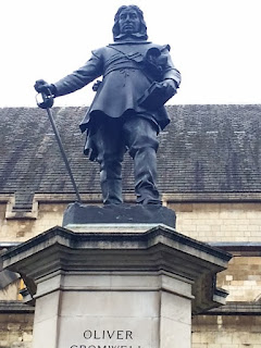 Pic of Oliver Cromwell's statue looking up at him looking down