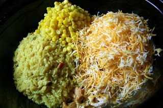 Rice, corn and cheese being added to the crockpot