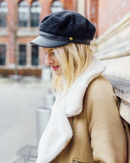 baker boy hat, fashion week, shearling jacket, aviator coat,