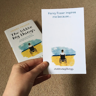 A hand holding a postcard sized insert from the book, reading 'Henry Fraser inspires me because...'