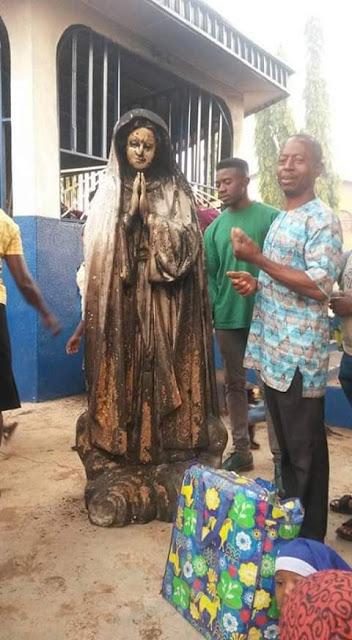 Photos: Woman sets statue of Virgin Mary ablaze at a Catholic Church in Enugu