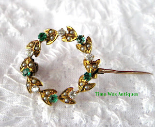 https://timewasantiques.net/products/edwardian-brooch-pin-9kt-gold-wreath-diamonds-emeralds-pearls-hand-made-1900