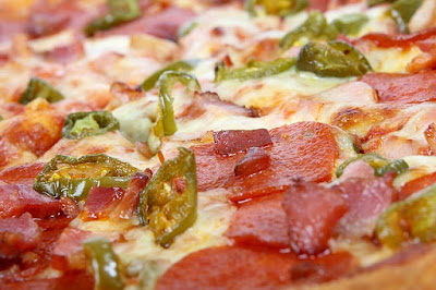 Various Pizza Toppings Like Canadian Bacon, Green Chilies, Cheese