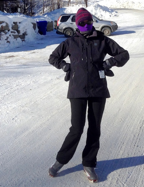 woman wearing ski pants, jacket, toque, and face mask near Lac Morency, Quebec, winter 2015