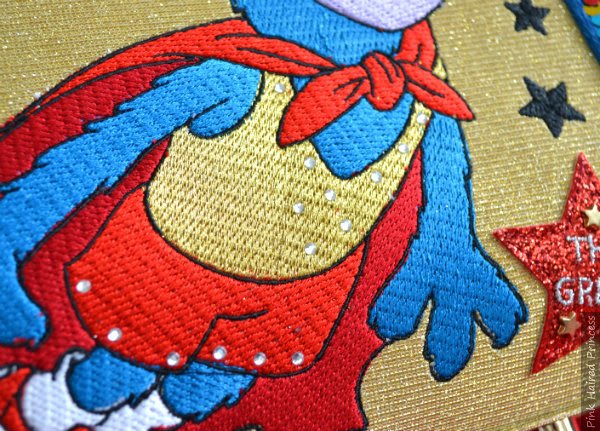 close up of gems on embroidered Gonzo on handbag