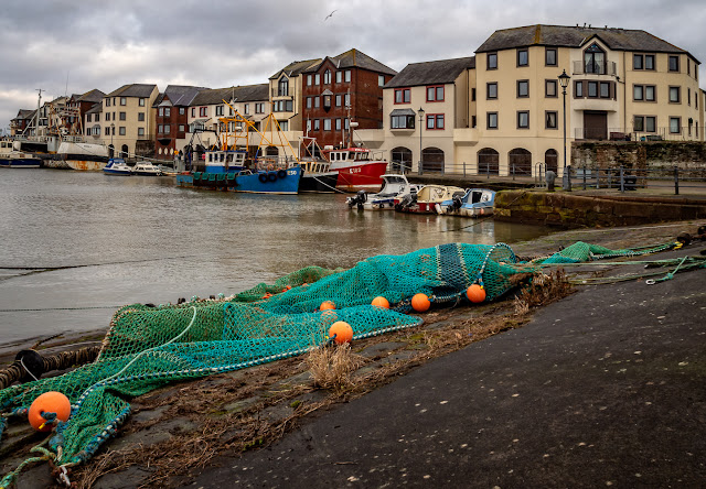 Photo of a fishing net spread out to dry in Maryport Harbour