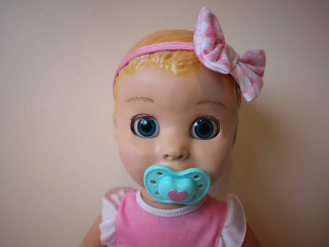 A picture of the blonde Luvabella doll