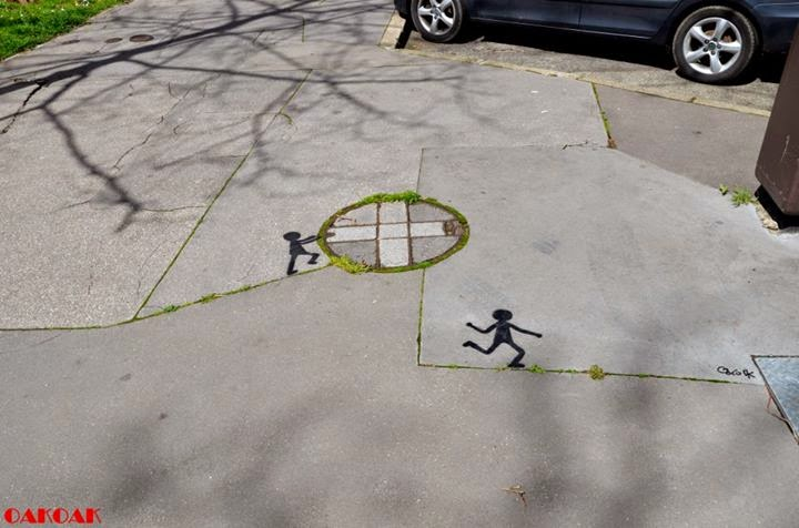 22-Playing-Ball-OakOak-Street-Art-Drawing-in-the-City-www-designstack-co