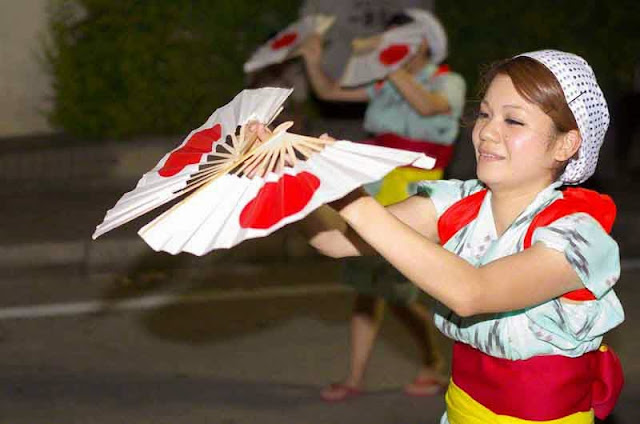 young woman with fans, Eisa dance