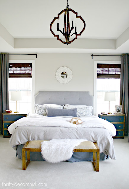 Master bed between two windows